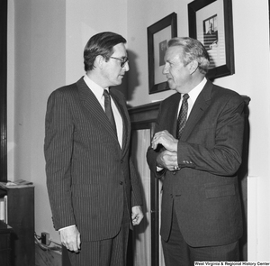 "[""Senator John D. (Jay) Rockefeller and an unidentified man speak in the Senator's office.""]%"