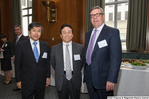 "[""Industry leaders stand together for a photo at a Welcome to Washington luncheon.""]%"