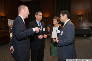 "[""Industry leaders talk to one another at a Welcome to Washington luncheon.""]%"
