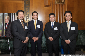 "[""Four industry leaders stand together for a photo at a Welcome to Washington luncheon.""]%"