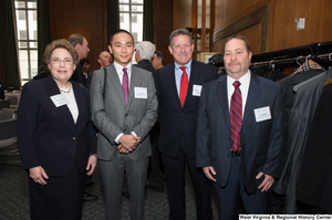 "[""Four industry leaders stand together for a photo at a Welcome to Washington luncheon event.""]%"