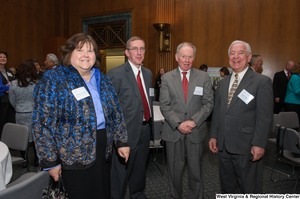 "[""Representative Nick Rahall stands with three industry leaders at a Welcome to Washington luncheon.""]%"