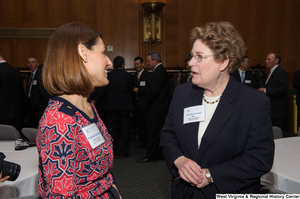 "[""Rochelle Goodwin speaks with a BB&T executive at a Welcome to Washington luncheon.""]%"