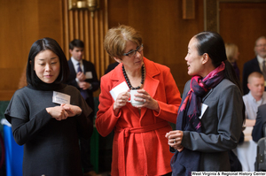 "[""Three industry leaders talk during a Welcome to Washington luncheon.""]%"