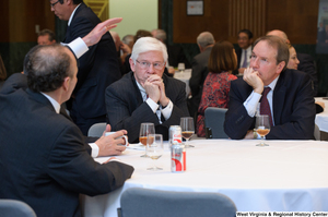 "[""Three industry leaders sit at a table together at a Welcome to Washington luncheon.""]%"