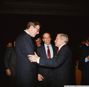 "[""Senator John D. (Jay) Rockefeller shakes hands with an unidentified man at a banquet event at the Senate.""]%"