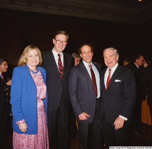 "[""Senator John D. (Jay) Rockefeller and Sharon Rockefeller stand with staff members during an event in the Senate.""]%"