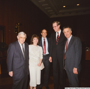 "[""Senator John D. (Jay) Rockefeller stands with staff members during an event at the Senate.""]%"