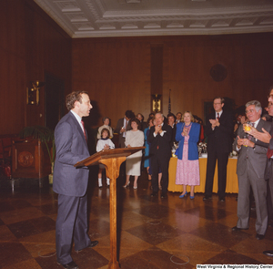 "[""A member of Senator John D. (Jay) Rockefeller's staff speaks at an event at the Senate.""]%"