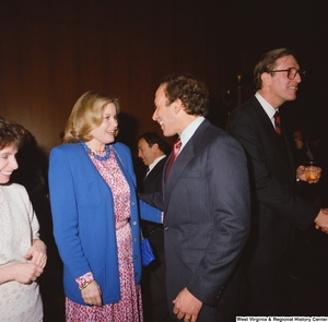 "[""Sharon Rockefeller speaks with one of her husband's staffers at a banquet event in the Senate.""]%"