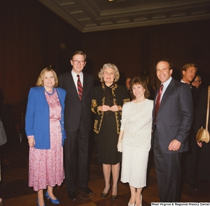 "[""Senator John D. (Jay) Rockefeller stands with Sharon and members of his staff at a banquet event in the Senate.""]%"