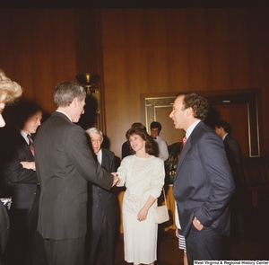 "[""One of Senator John D. (Jay) Rockefeller's staff members speaks with guests at an event in the Senate.""]%"