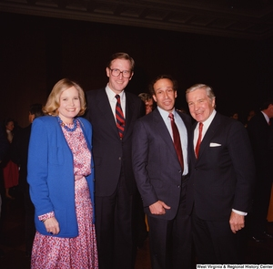 "[""Senator John D. (Jay) Rockefeller and Sharon Rockefeller stand with two staff members during a banquet at the Senate.""]%"