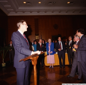 "[""Senator John D. (Jay) Rockefeller speaks to the audience at an event in the Senate.""]%"