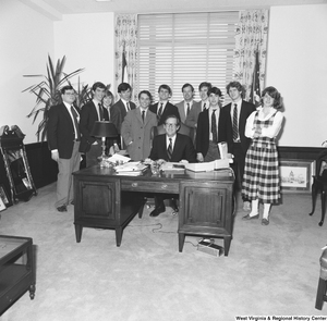 "[""Senator John D. (Jay) Rockefeller is photographed in his office with an unidentified group of student visitors.""]%"