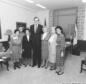 "[""Senator John D. (Jay) Rockefeller stands for a photograph with several representatives from the West Virginia Federation of Business and Professional Women.""]%"