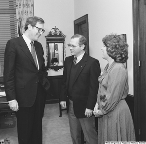 "[""Senator John D. (Jay) Rockefeller laughs with the West Virginia \""Engineer of the Year\"" and his wife.""]%"