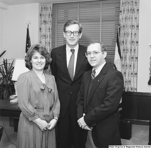 "[""Senator John D. (Jay) Rockefeller stands for a photograph with the West Virginia \""Engineer of the Year\"" and his wife.""]%"