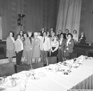 "[""A group of National Association of Postmasters of the United States (NAPUS) members gather for a photograph at an event at the Senate.""]%"
