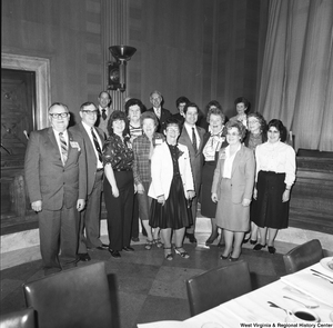 "[""Unidentified members of the National Association of Postmasters of the United States gather for a photograph during an event at the Senate.""]%"