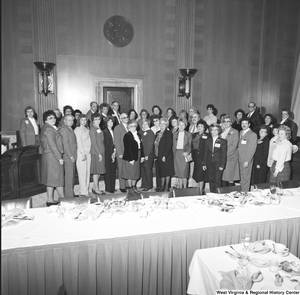 "[""Unidentified members of the National Association of Postmasters of the United States gather for a photograph during an event at the Senate. (This photo is from a wider angle and includes all members present.)""]%"