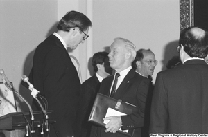 "[""Senator John D. (Jay) Rockefeller speaks to an unidentified man after a press event.""]%"
