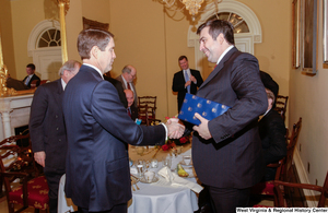 "[""Two men shake hands after a luncheon at the Senate.""]%"