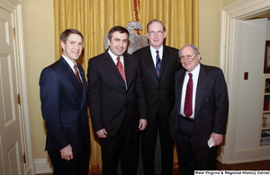 "[""Senator John D. (Jay) Rockefeller poses for a photograph with three unidentified men after a luncheon in the Senate.""]%"