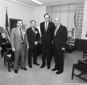 "[""Senator John D. (Jay) Rockefeller stands with three representatives from the West Virginia Christian Schools Association in his office.""]%"