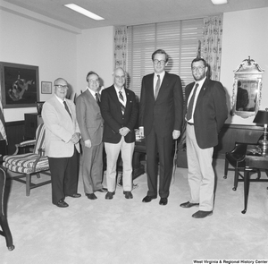"[""Senator John D. (Jay) Rockefeller stands with four representatives from Huntington Parks in his office.""]%"