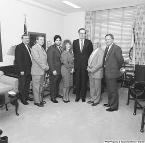 "[""Senator John D. (Jay) Rockefeller stands with a group of six individuals from National Home Study in his office.""]%"