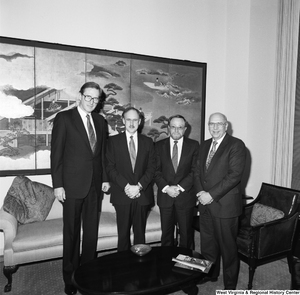"[""Senator John D. (Jay) Rockefeller stands for a photograph with two representatives from University Health Associates and the Dean of the WVU School of Medicine.""]%"