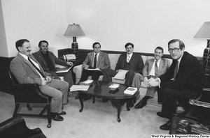 "[""Senator John D. (Jay) Rockefeller meets with an unidentified group of unemployed miners in his office.""]%"