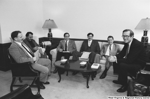 "[""An unidentified group of unemployed coal miners meets with Senator John D. (Jay) Rockefeller in his office.""]%"