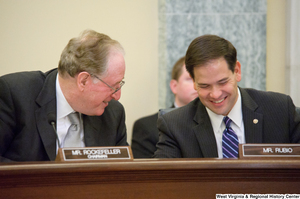 "[""Senators John D. (Jay) Rockefeller and Marco Rubio laugh together at a Commerce Committee hearing.""]%"