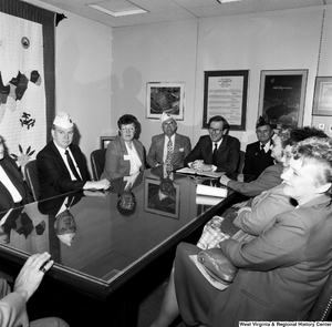 "[""Senator John D. (Jay) Rockefeller sits at a conference table with members of the American Legion.""]%"