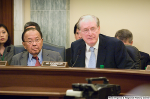 "[""Senators John D. (Jay) Rockefeller and Daniel Inouye sit at a Commerce Committee hearing.""]%"