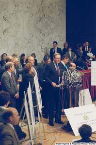 "[""Senator John D. (Jay) Rockefeller stands at a Pepper Commission press conference.""]%"