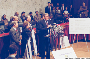 "[""Senator John D. (Jay) Rockefeller stands behind a set of microphones at a Pepper Commission press event.""]%"