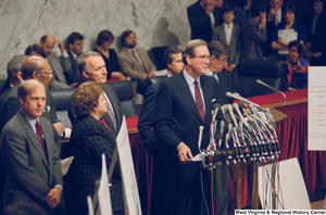 "[""Senator John D. (Jay) Rockefeller stands behind the microphones at a press conference for the Pepper Commission.""]%"