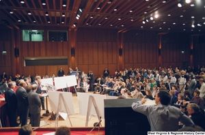"[""This photograph is a wide shot that shows a large room full of members of the media who are watching Senator John D. (Jay) Rockefeller speak during a Pepper Commission press conference.""]%"