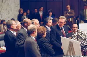 "[""Senator John D. (Jay) Rockefeller looks to his side during a Pepper Commission press conference.""]%"