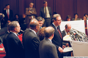 "[""Senator John D. (Jay) Rockefeller stands and looks out at the media after a Pepper Commission press event.""]%"