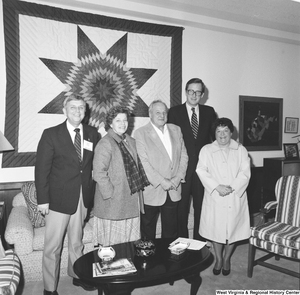 "[""Senator John D. (Jay) Rockefeller poses for a photograph with four unidentified individuals in his Washington office.""]%"