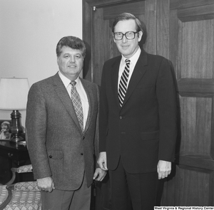 "[""Senator John D. (Jay) Rockefeller meets with an unidentified individual in his office in Washington, D.C.""]%"