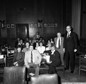 "[""West Virginia representatives from the National League of Postmasters sit for a photograph with Senator John D. (Jay) Rockefeller in a Senate office building.""]%"