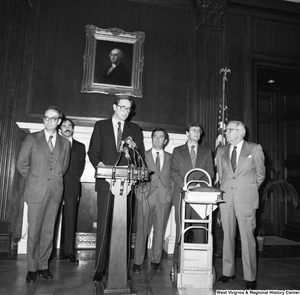 "[""Senator John D. (Jay) Rockefeller speaks at a Staggers Rail Reform press event in a Senate building.  Congressmen Nick Rahall and Bob Wise and a man who appears to be Senator Rockefeller's Press Secretary, Timothy Gay, stand behind the Senator.""]%"