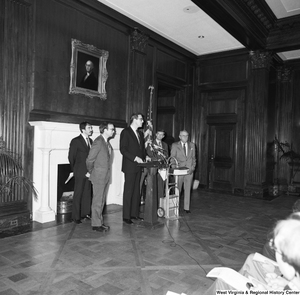 "[""This photograph was taken from a distance, but shows Senator John D. (Jay) Rockefeller speaking at a Staggers Rail Reform press event in a Senate building.""]%"