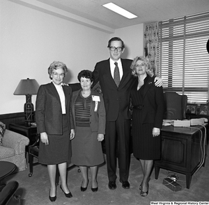 "[""Three Marion County, WV officials pose for a photograph with Senator John D. (Jay) Rockefeller in his Washington office.""]%"