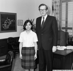 "[""Senator John D. (Jay) Rockefeller is photographed with an unidentified individual in his Washington office.""]%"